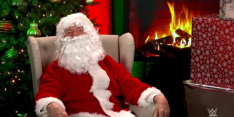 Mr. McMahon introduces the Women's Tag Titles dressed as Santa Claus