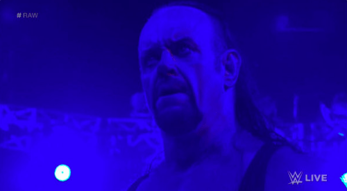The Undertaker RETURNS on RAW and saves Roman Reigns