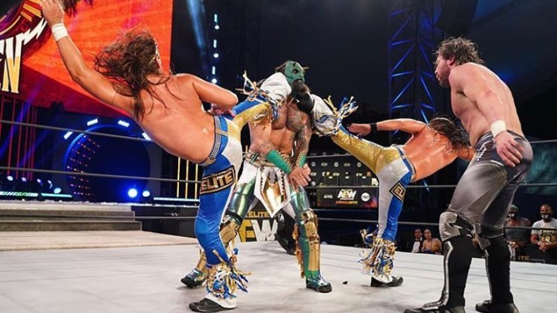 Luchasaurus receives Superkicks from The Young Bucks
