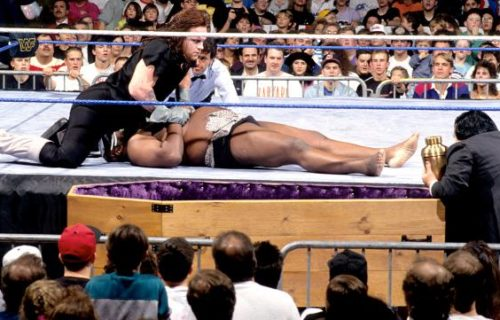 Undertaker faces Kamala in a Coffin Match
