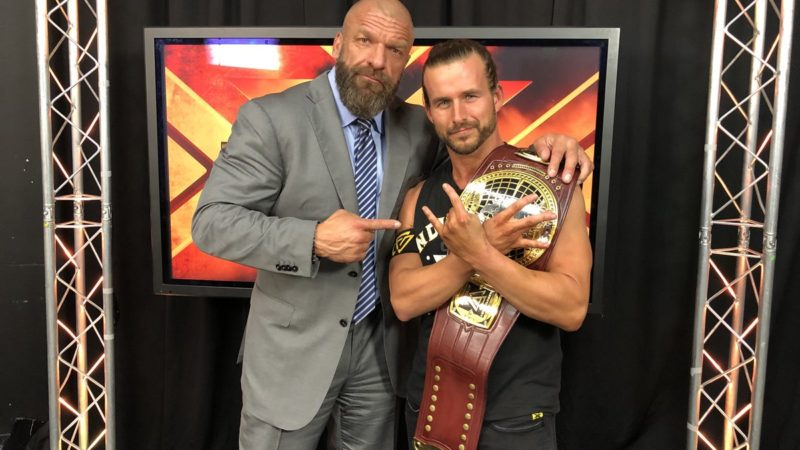 Adam Cole with Triple H