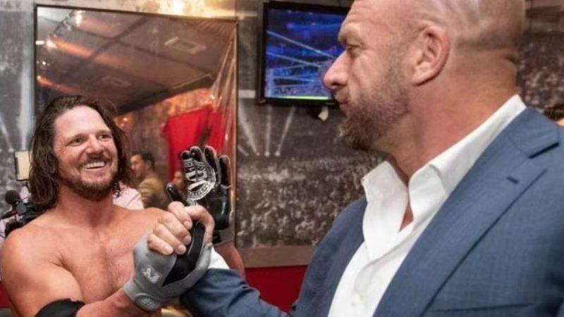 AJ Styles with Triple H